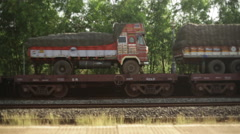 Train transporting truck vehicles, long shot Stock Footage