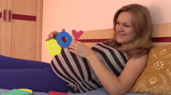Pregnant woman expecting boy. - stock footage