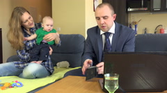 Wife with baby and worried husband plan family budget. 4K Stock Footage