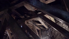 Old attic with wooden beams. 4K. Stock Footage