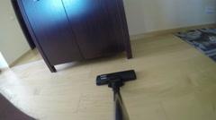 Vacuum cleaner tool suck dust on wooden floor under cabinet. 4K Stock Footage