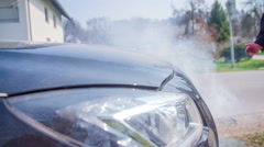 Smoke coming beneath the hood - stock footage