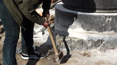 Sledge hammer blows of granite stones. 4K. Stock Footage