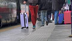 Commuter Crowd of people walk down the train station. 4k UHD stock footage. Stock Footage