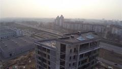 Rising up along the wall of constructed building Stock Footage