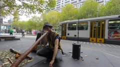A street musician playing Didgeridoo. No Sound Stock Footage