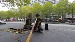 A street musician playing Didgeridoo Stock Footage