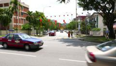 Sunny street T-junction, green suburb area, car traffic and chinese decoration Stock Footage