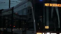 New streetcar not in service passes person at stop Stock Footage