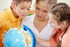 Studying geography Stock Photos