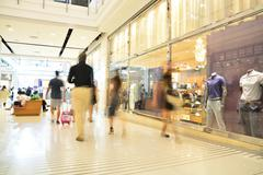 Blur or Defocus Background of People Walking or Shopping in Modern Building. Stock Photos