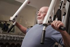 Senior Adult Man Working Out in the Gym. - stock photo