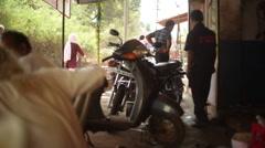 Motorbike mechanic shop, India, long shot, shallow DOF Stock Footage