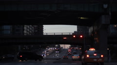 Underpass traffic busy intersection at dusk Stock Footage