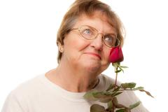 Attractive Senior Woman with Red Rose Isolated on a White Background. - stock photo