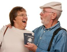 Happy Senior Couple with Passports and Bags Isolated on a White Background. - stock photo