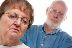 Angry Senior Couple in a Terrible Argument - stock photo