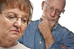 Angry Senior Couple in a Terrible Argument. - stock photo