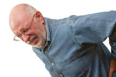 Agonizing Senior Man with Hurting Back on a White Background. Stock Photos