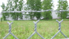 Camera Moving up Chain Link Fense to Barbed Wire Stock Footage
