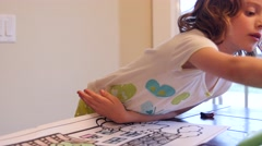 Girl coloring in her coloring book Stock Footage