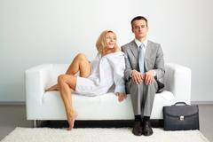 Couple on sofa Stock Photos