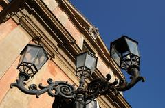 Bottom perspective of a lamppost in iron Stock Photos