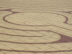 Labyrinth motif on floor - stock photo