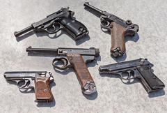 Different old combat pistols Stock Photos