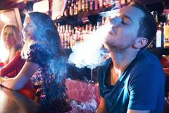 Enjoying hookah Stock Photos