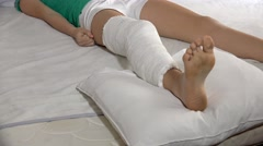 4k Patient with broken leg in a plaster cast in hospital bed. UHD steadycam s Stock Footage