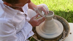 hands of a potter, creating a clay jar - stock footage