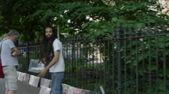 Rastafarian selling Bebop record near West 4th Street, slow motion 4K, NYC Stock Footage