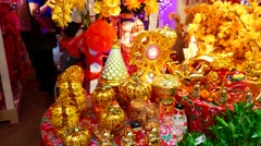 Golden watnot and houseware, Chinese New Year decorations for home Stock Footage
