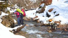 A group of tourists will boost mountain river - stock footage