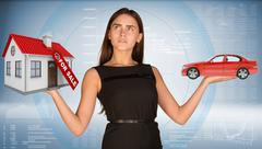 Businesslady holding car and house Stock Photos