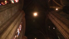 Columns and candles in the Catholic cathedral . Milan Dome Stock Footage