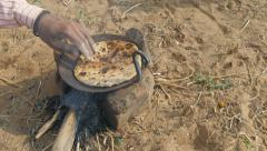 Preparing fresh chapati bread on a stove in the deserts near Pushkar, India Stock Footage