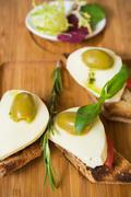 Bruschetta with tomato, mozarella and olive - stock photo