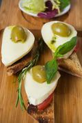 Bruschetta with tomato, mozarella and olive Stock Photos