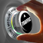 Hand rotating a button and selecting the level of traffic. - stock illustration