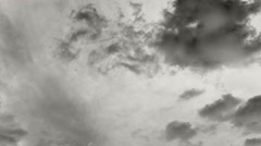 Timelapse - black clouds moving in two directions - black and white - 4k Stock Footage