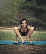 Beautiful girl is engaged in yoga in the forest Stock Photos