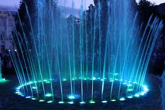 Colored fountains in city park Stock Photos