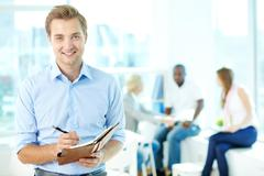 Man with notepad - stock photo