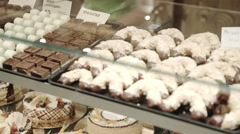 Different cakes and sweets on showcase Stock Footage