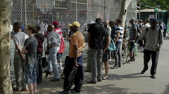 Spectators Watching Game through Fence West 4th Street Basketball Courts 4K NYC Stock Footage