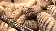 Different bread and bread slices. Food background Stock Footage