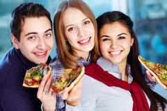 Hungry friends - stock photo
