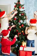 Decorating firtree - stock photo